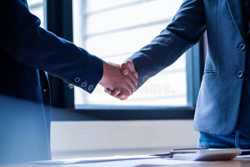 Business people shaking hands in meeting room, Successful deal after meeting royalty free stock images