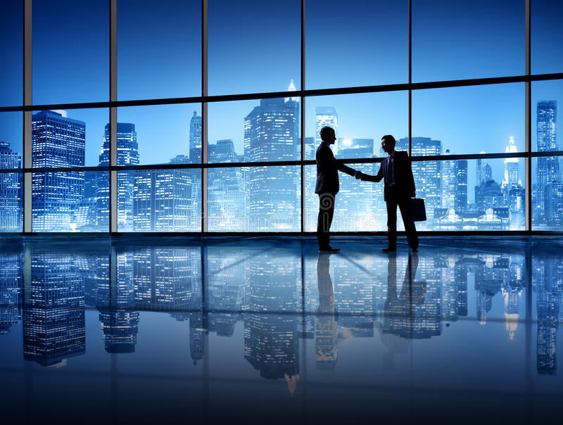 Business People Shaking Hands in New York City royalty free stock photo