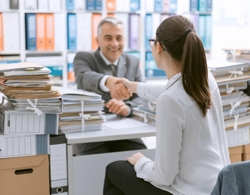 Business people shaking hands in the office stock photo
