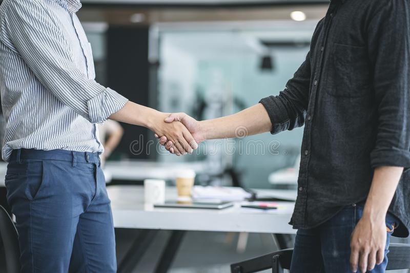Business people shaking hands at the office. Success teamwork, partnership and handshake business concept royalty free stock photography