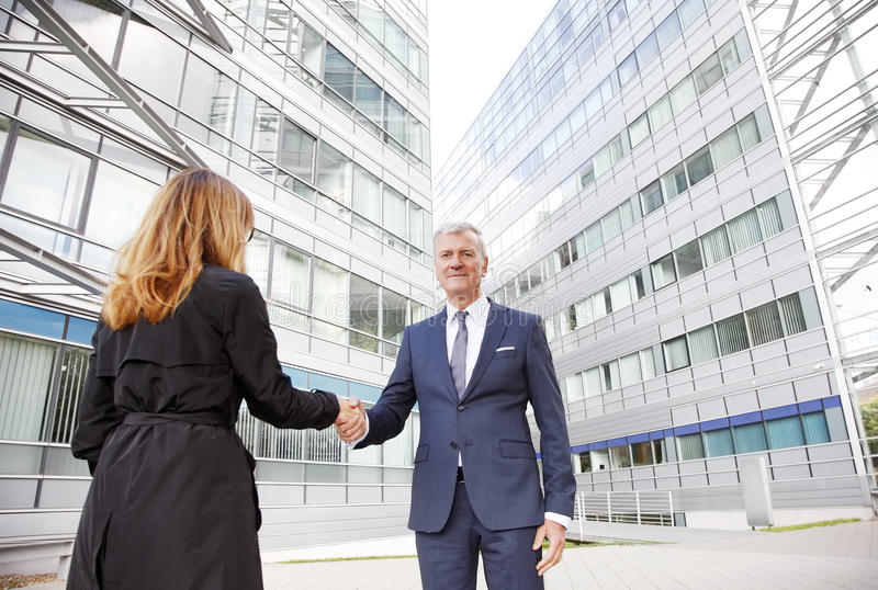 Business people shaking hands stock image