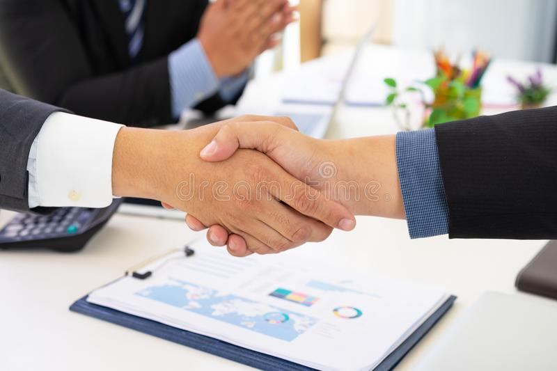 Business people shaking hands successful deal after great meeting. stock photo