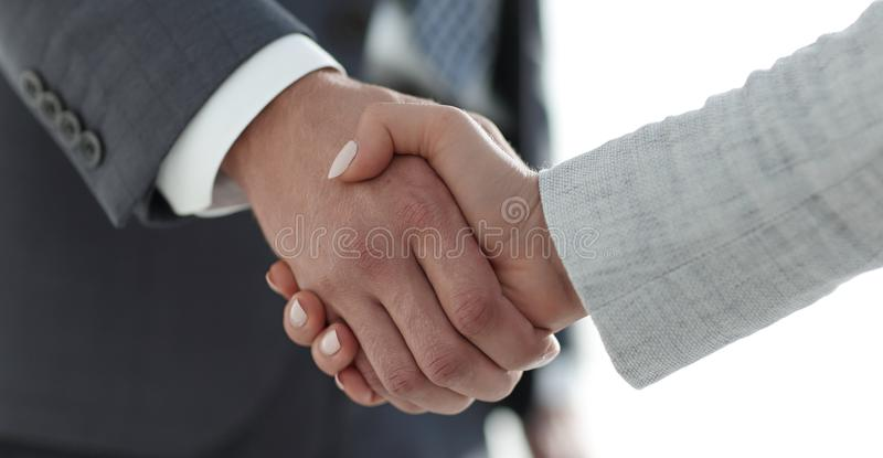 Business people shaking hands on white background. Business people handshake in modern office. Greeting deal concept stock photography