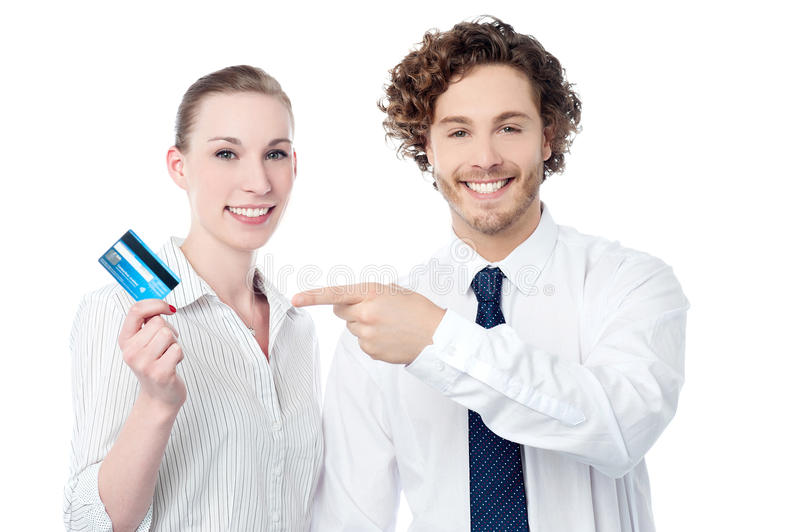 Business people showing credit card. Young business executives displaying credit card stock photography