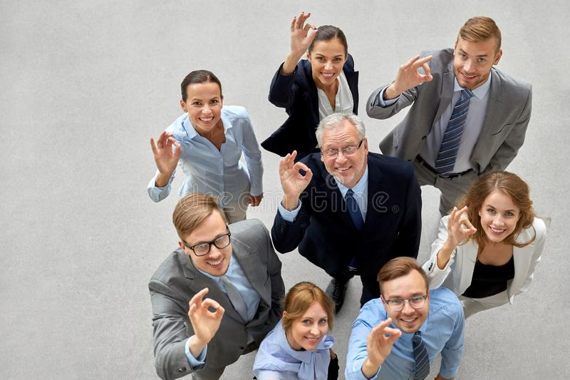 Business people showing ok hand sign at office stock photography