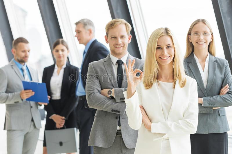 Business people showing ok stock photos