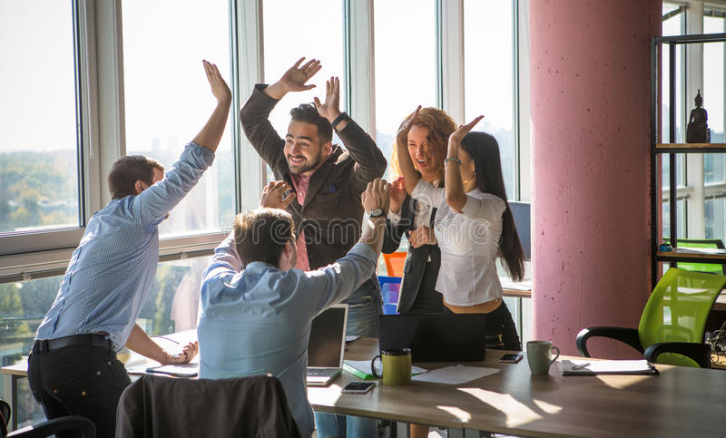 Business people showing team work in office stock image
