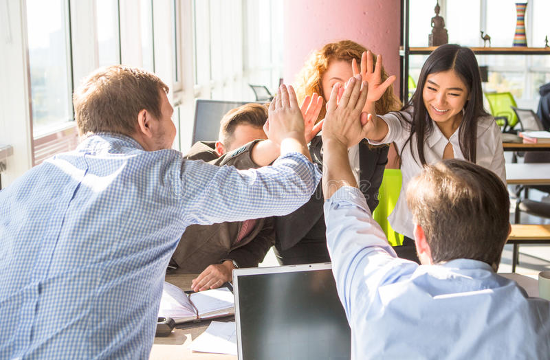 Business people showing team work in office stock images
