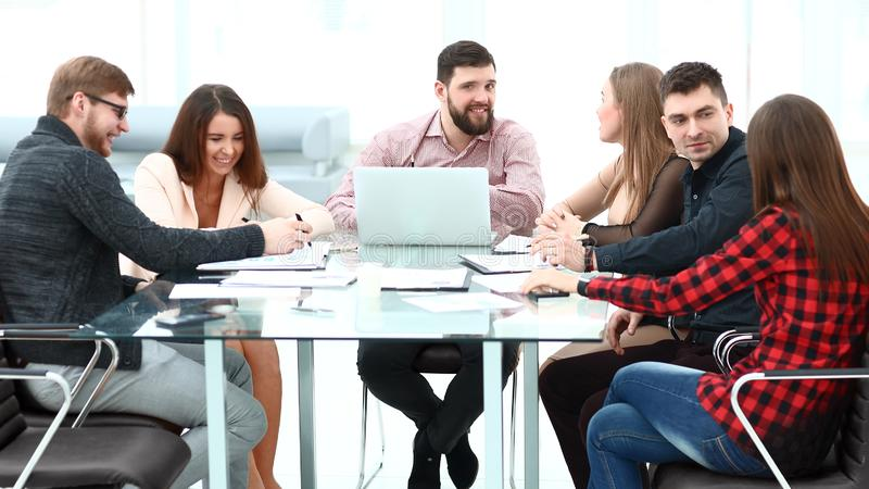 Business people showing team work while working in board room in office interior. royalty free stock photography