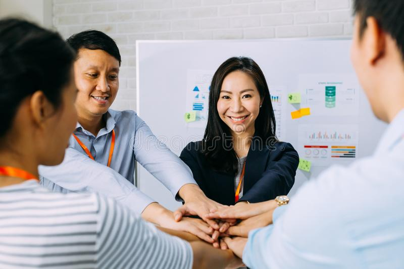 Business people showing unity and collaboration gesture stock photos