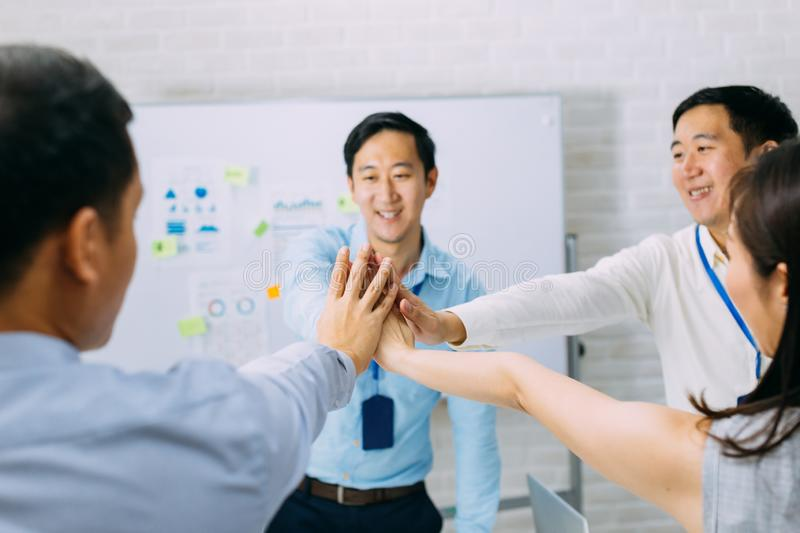 Business people showing unity and collaboration gesture stock photography