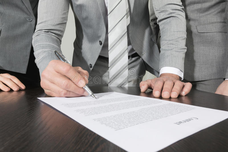 Business people sign contract stock photos