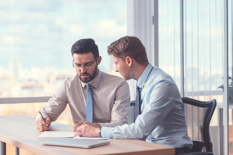 Business people signing a contract stock photography
