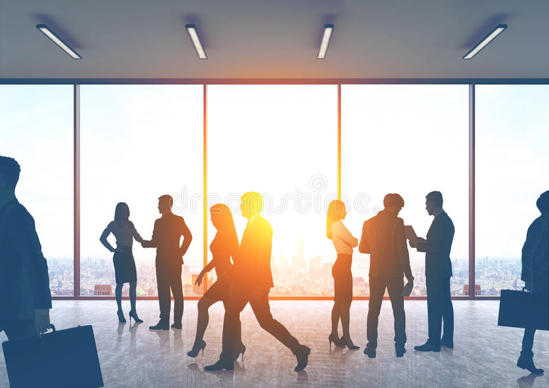 Business people silhouettes in an office hall vector illustration