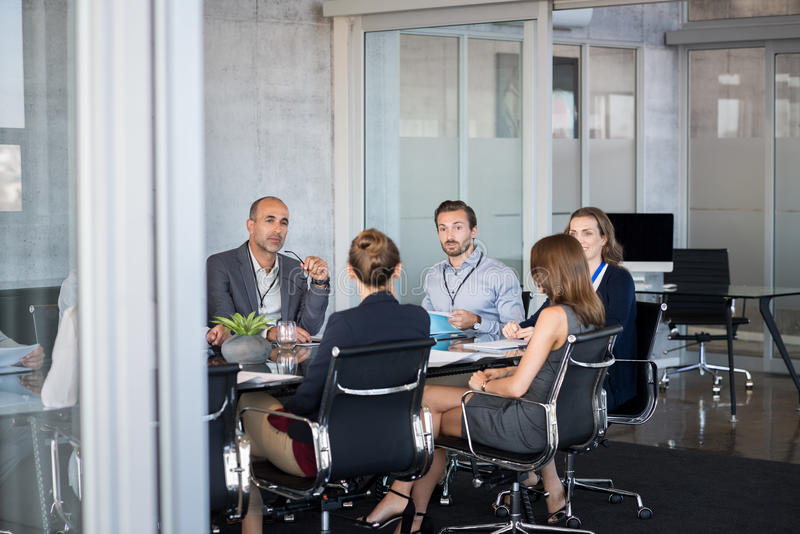 Business meeting. Business people sitting in boardroom and working together at new strategy plan. Group of leader and businesspeople in a meeting at office stock photos