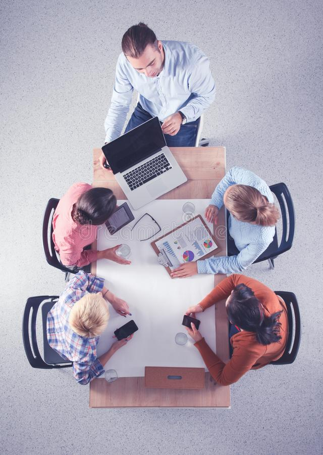 Business people sitting and discussing at business meeting, in office royalty free stock image