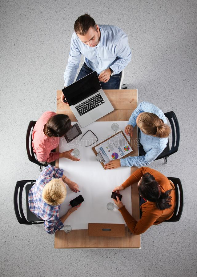 Business people sitting and discussing at business meeting, in office stock photos