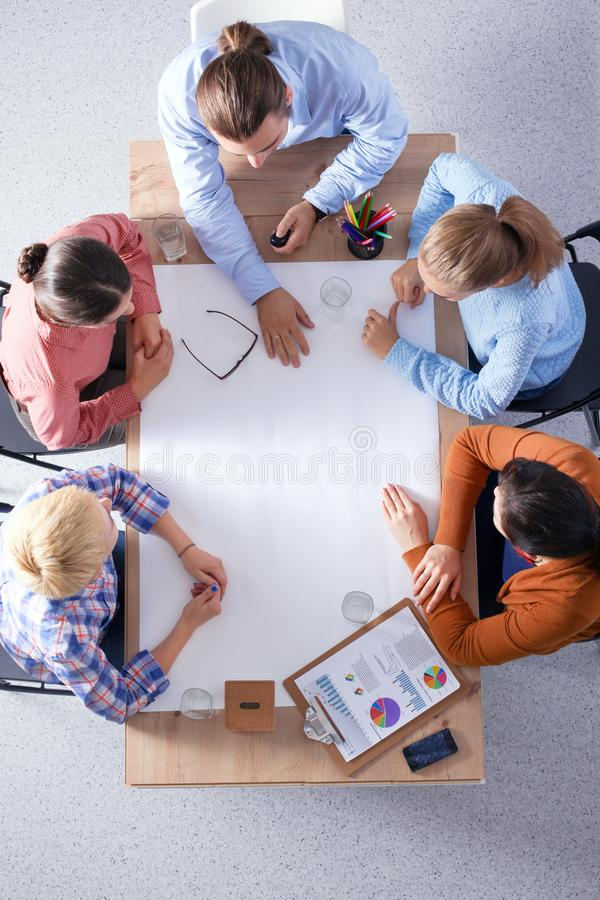 Business people sitting and discussing at meeting, in office royalty free stock photo