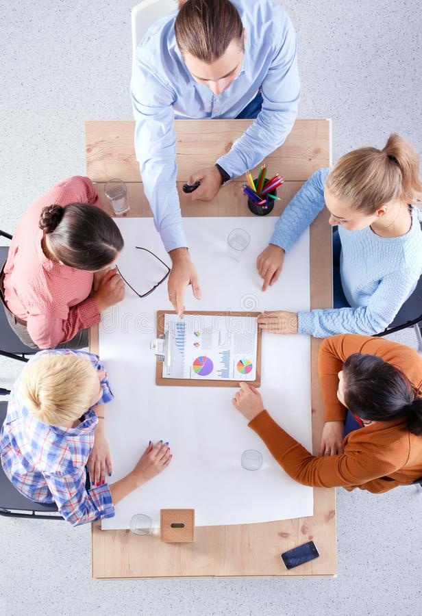 Business people sitting and discussing at meeting, in office royalty free stock photography
