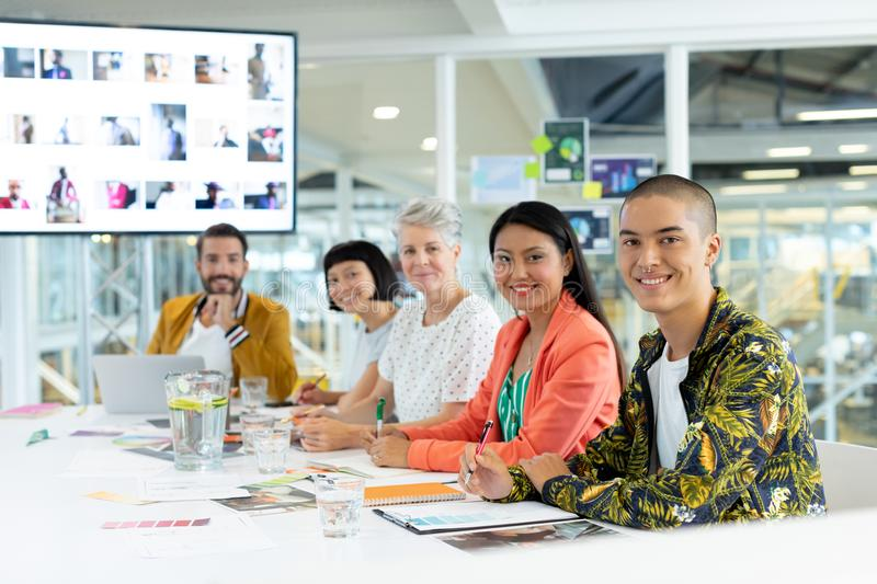 Business people sitting in the meeting at the conference room at office. Portrait of diverse business people sitting in the meeting at the conference room at stock image