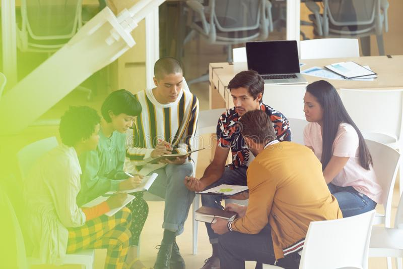 Business people sitting together and having group discussion in office. High angle view of diverse Business people sitting together and having group discussion stock image