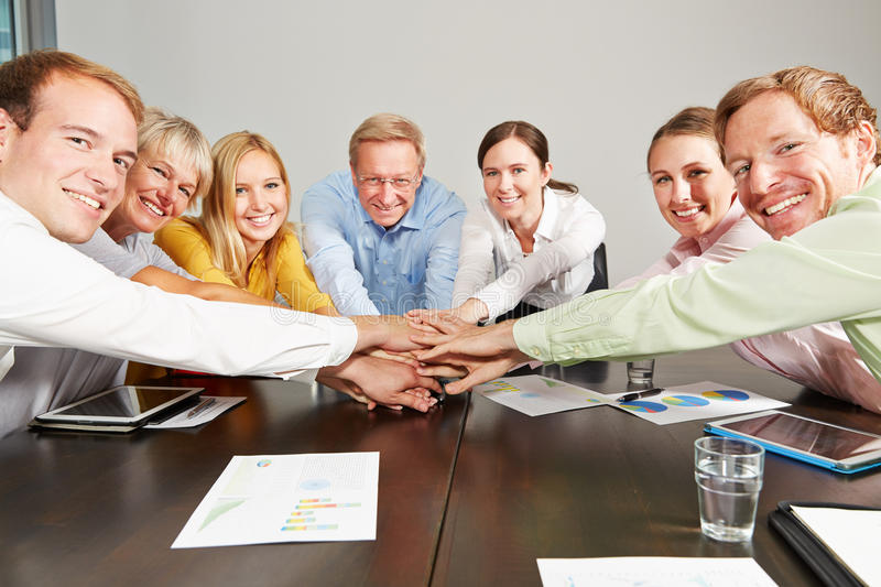 Business people stacking hands for motivation stock photography