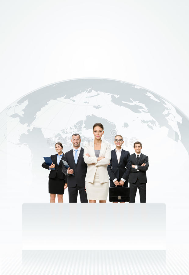 Business people standing in front of an earth map. Successful businessmen standing in front of an earth map royalty free stock images