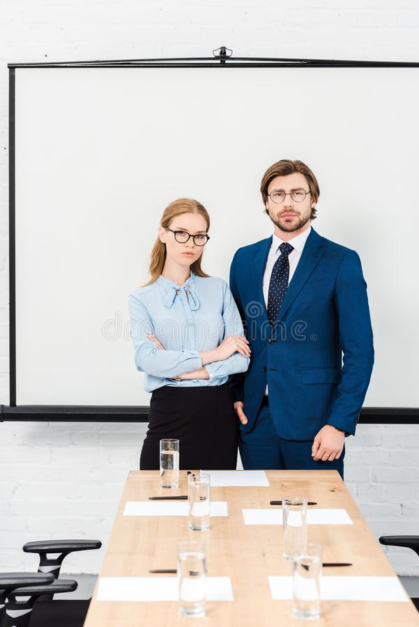 business people standing at modern office and looking at camera in front of blank stock photos