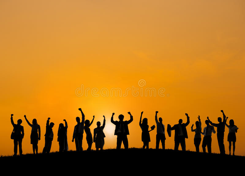 Business People Standing Outdoors Celebrating Success stock images