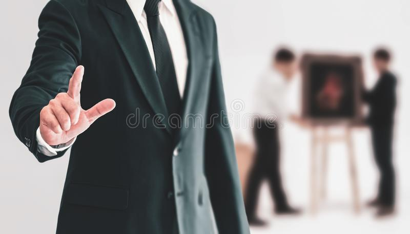 Business people standing and pointing a finger with confidence i royalty free stock photography