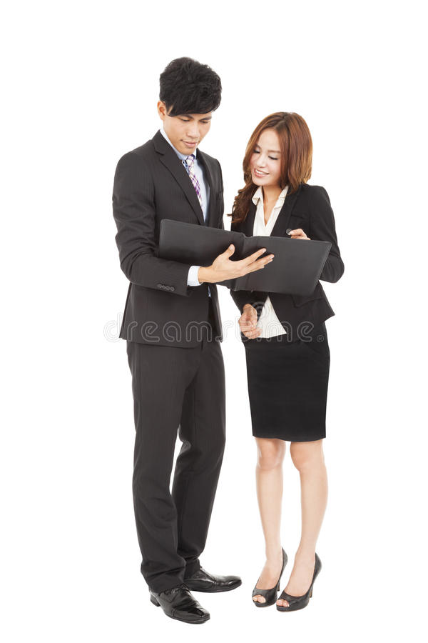 Business people standing and reading document together royalty free stock images