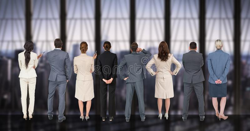 Business people standing in a row against digitally generated background royalty free stock photography