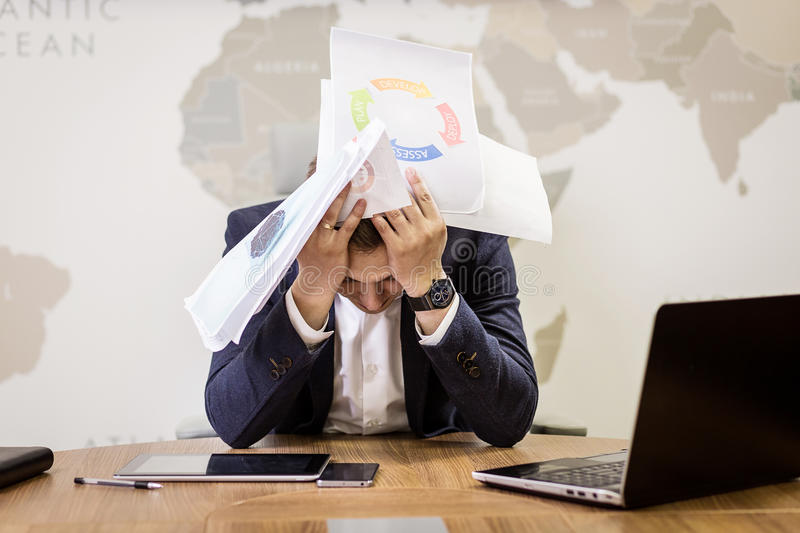 business, people, stress, emotions and fail concept - angry businessman throwing papers in office stock image