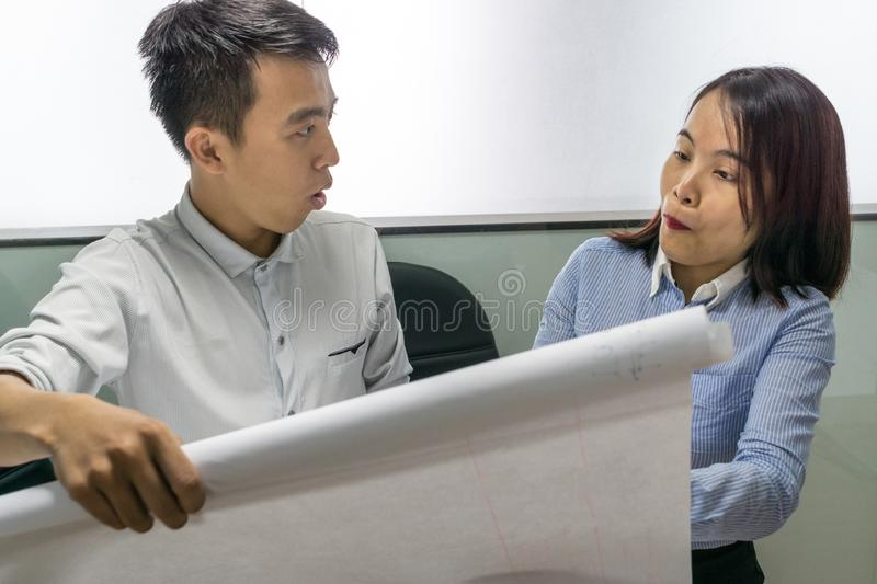 Business people surprise with new project on drawing paper stock photography
