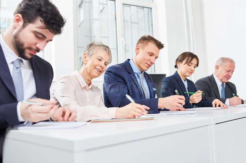 Business people take seminar test. For human resources royalty free stock photo