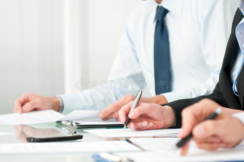 Business people taking notes stock images