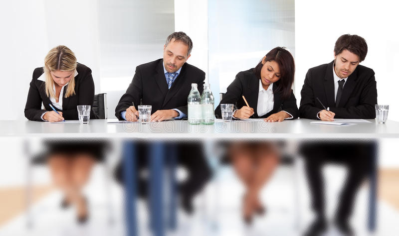 Business people taking notes at the meeting stock photos