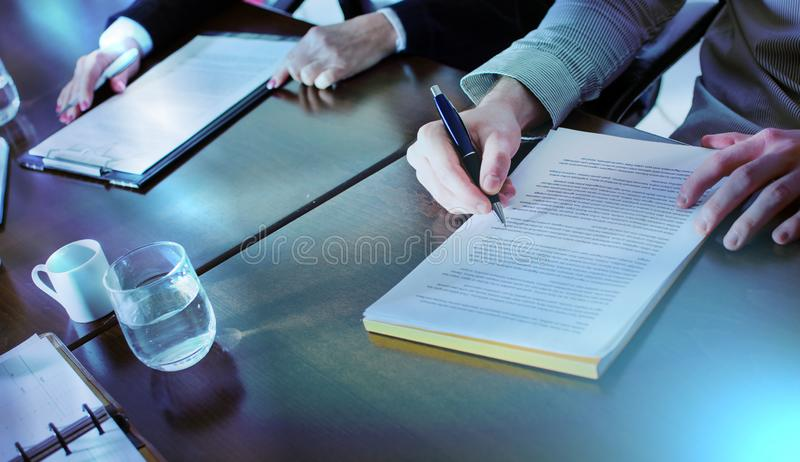 Business people taking notes; light effect royalty free stock photos