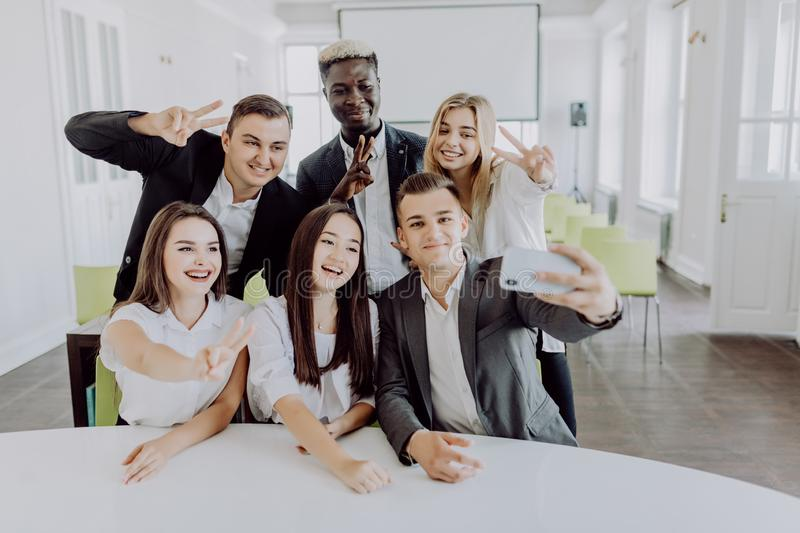Business people taking selfie of themselves in the office. Team work royalty free stock photos