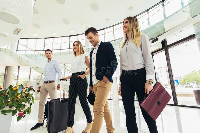 Business people talk and walk together with luggage stock photos