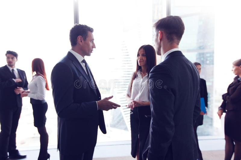 Business people. Talking in a conference room with city skyline royalty free stock photos