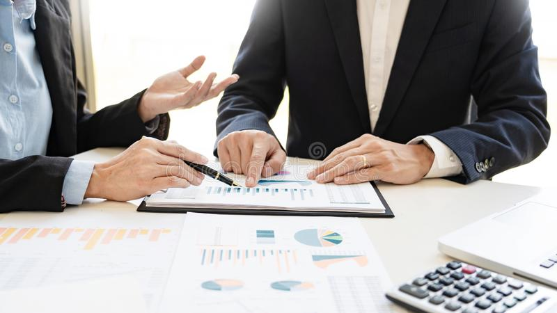 Business People Talking Discussing with coworker planning analyzing financial document data charts and graphs in Meeting and. Successful teamwork Concept royalty free stock images
