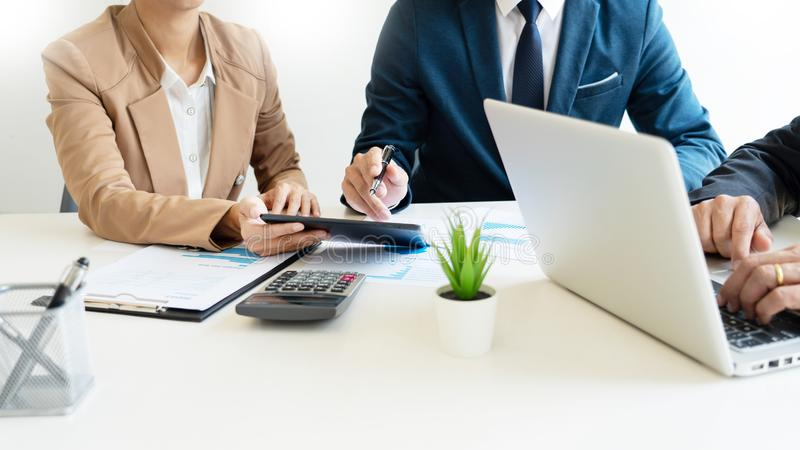 Business People Talking Discussing with coworker planning analyzing financial document data charts and graphs in Meeting and. Successful teamwork Concept royalty free stock image