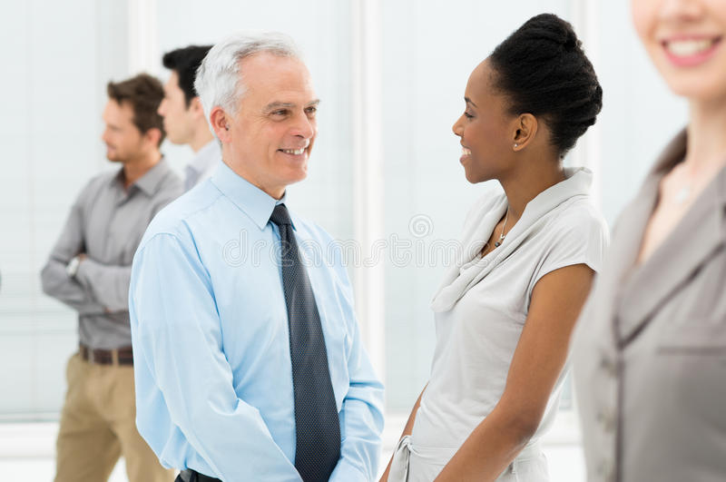 Business People Talking With Each Other stock photo