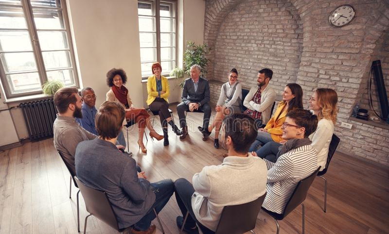 Business people talking at group meeting royalty free stock images