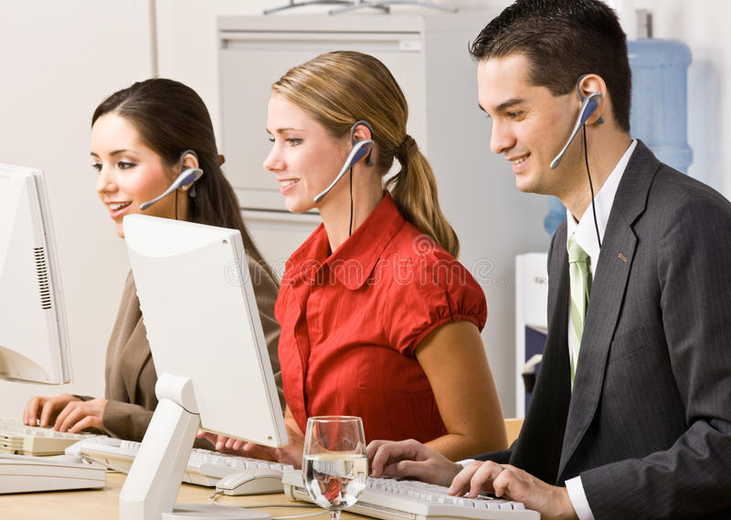 Download Business People Talking On Headsets Stock Image - Image: 17053119