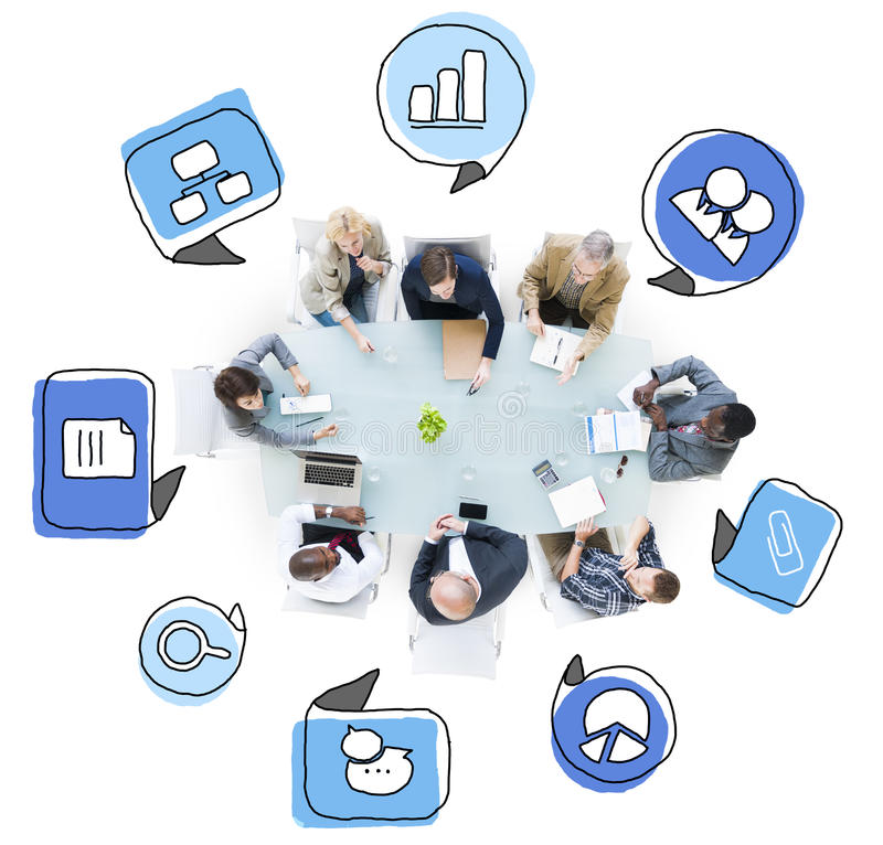 Business People Talking in a Meeting with Symbols.  stock image