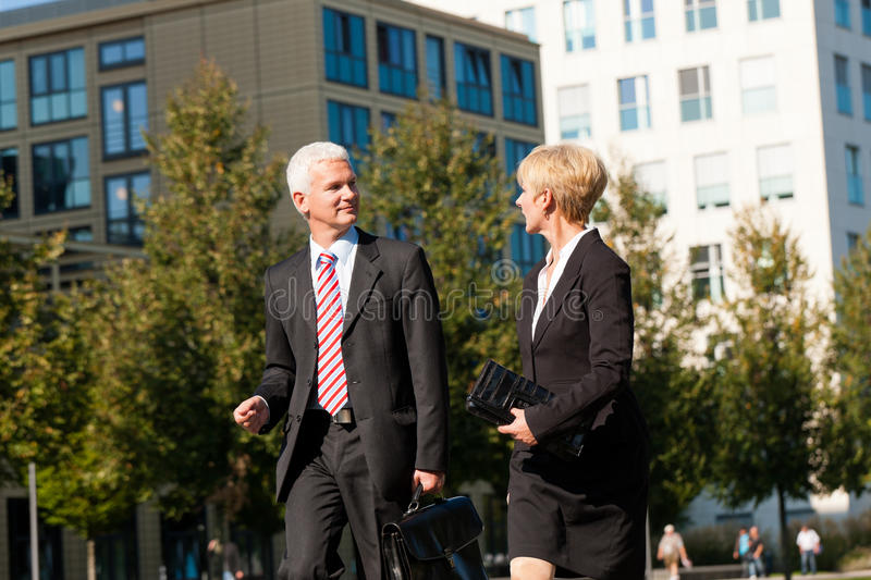 Business People Talking Outdoors Stock Images