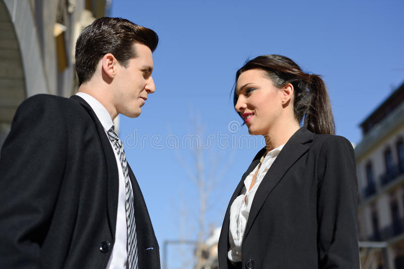 Business people talking outside of company building. Couple work royalty free stock photo