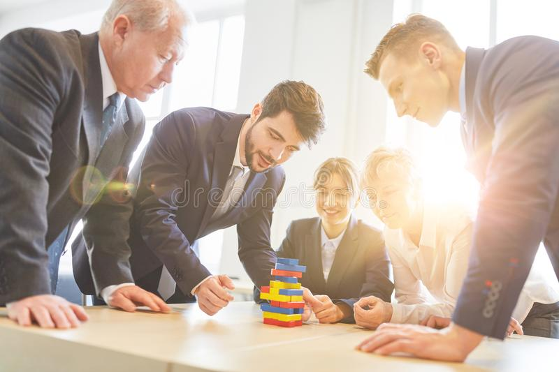 Business people in team building workshop royalty free stock photo